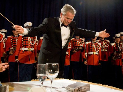 President Bush takes a bow at the 2008 White House Correspondents' Dinner. (photo/Neshan H. Naltchayan)