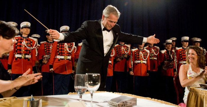 President Bush takes a bow at the 2008 White House Correspondents' Dinner. (photo/Neshan H. Naltchayan)